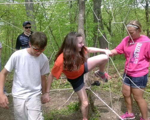 Group working through ropes course